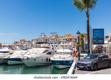 Marbella, SPAIN - July 16 2020: Luxury Puerto Jose Banus Harbour situated in Nueva Andalucia area of Marbella city. Luxury lifestyle with expensive yachts, shopping area with exclusive stores