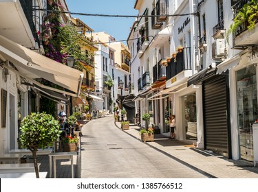 Marbella, Spain - June 27th, 2018. the little photographer on old  town street in Marbella, Costa del Sol, Andalusia, Spain, Europe