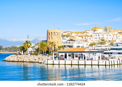 MARBELLA, SPAIN - MAY 9, 2018: View of Puerto Banus marina with boats and white houses in Marbella town, Andalusia. This port is famous destination for wealthy people.