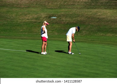 MARBELLA, SPAIN - NOVEMBER 12, 2008 - Two women playing golf on the putting green at the Rio Real Golf Club, Marbella, Costa del Sol, Malaga Province, Andalucia, Spain, Europe, November 12, 2008.
