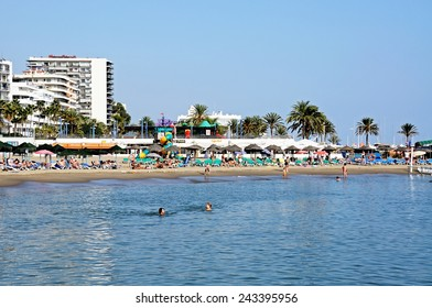 MARBELLA, SPAIN - SEPTEMBER 26, 2011 - Holidaymakers on the beach, Marbella, Costa del Sol, Malaga Province, Andalucia, Spain, Western Europe.