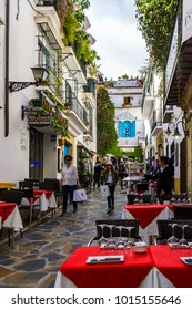 Marbella/Spain - April 27, 2017:  A narrow, busy street in the old town center of Marbella where visitors shop and enjoy fine meals at the open air cafes.