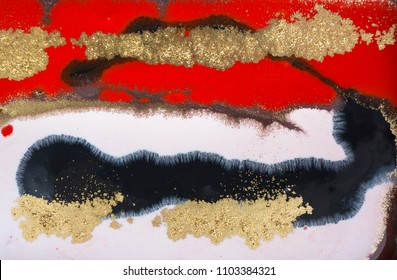 Marble abstract acrylic background. Red and gold marbling artwork texture. Agate ripple pattern