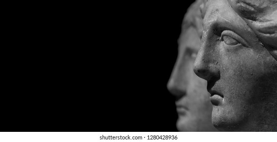 Marble ancient different heads as humankind in a isolated black background