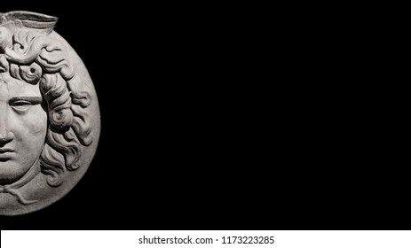 Marble ancient head of Greek mythological Medusa at isolated black background streamer with paste space