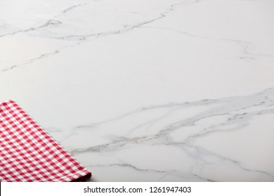 Marble background with plaid textile and copy space for text.