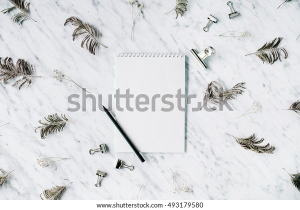 Marble background workspace with blank paper notebook. Flat lay, top view office table