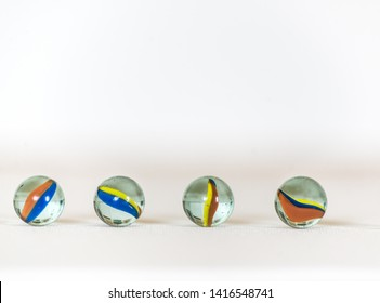 Marble balls on a white background, isolated, coloured. Closeup photo.