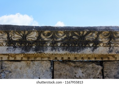 marble bas-relief flowers and patterns on top of the stone wall. ruins of the ancient city. Side, Turkey