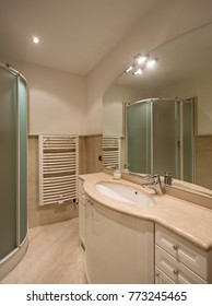 Marble bathroom and large mirror. Nobody inside