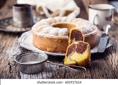 Marble cake cup of coffee powder sugar and kitchen vintage utensil.