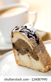 Marble Cake slice with cup of coffe