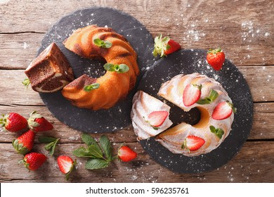 Marble cake and vanilla cake with strawberries close-up on the table. horizontal view from above