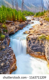 Marble Canyon waterfall atop a narrow  limestone gorge eroded by the pounding waters of Tokumm Creek above its confluence with the Vermilion River in Kootenay National Park near Banff in the Canada.