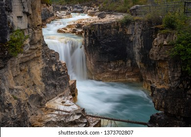 Marble Canyon Waterfall, Kootenay National Park, Canada in full force, taken with a long exposure to smooth out the water and give a milky appearance