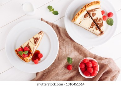 Marble Cheesecake Dessert Raspberry Top Down View. Chocolate Cheese Cake Piece on White Plate Flat Lay. Baked Vanilla Pastry Mint Syrup Decorating. Sweet Brown Pie from Bakery on Wooden Background