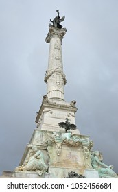 Marble column of the Monument aux Girondins in the cloudy sky of the French city Bordeaux