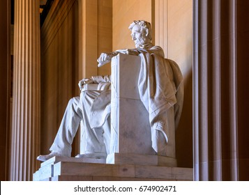 The marble columns and Abraham Lincoln statue at the Lincoln Memorial on a sunny spring day in Washington DC, USA