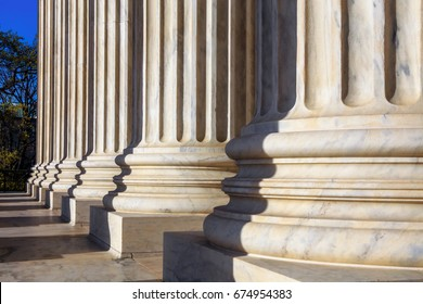 The marble columns of the main portico at the Supreme Court on a sunny spring day in Washington DC, USA