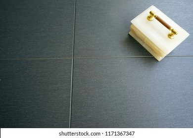Marble container on black floor