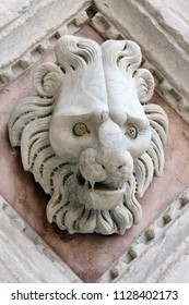 marble detail of carved head of lion on church in Siena