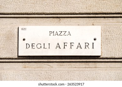 "Marble ensign indicating ""Piazza degli Affari"", where are the Italian stock market (""Borsa Italiana"") headquarters"
