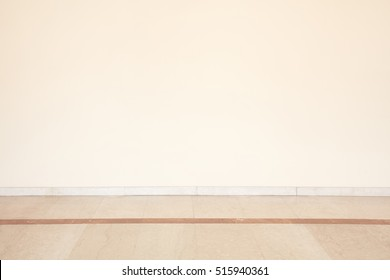 Marble floor in empty room with blank wall