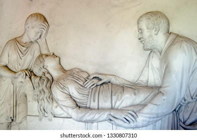 Marble frieze showing Earl Kilmorey comforting his mistress as she lies on her deathbed in 1854 with their son David at her head.  Part of the historic Kilmorey Mausoleum.