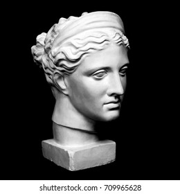 Marble head of young woman, ancient Greek goddess bust on black background