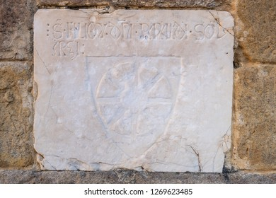 Marble inscription to the convent of San Francesco Roman Catholic church in Gothic style in the medieval village of Colle di Val d'Elsa, Siena, Tuscany