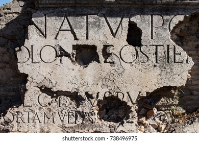 Marble inscription on a Roman ruin in ancient Ostia. Example of entry originally placed on an ancient Rome architecture. SPQR