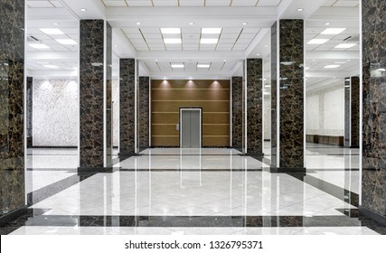 Marble interior of luxury lobby of commercial building or hotel. Clean corporate hall with real floor tile. Shiny floor with reflections in modern office after professional cleaning service. - Shutterstock ID 1326795371