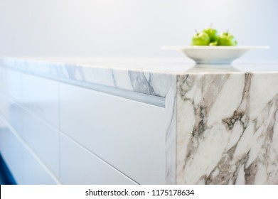 Marble kitchen bench top, close up view showing mitred corner