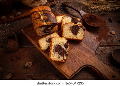 Marble loaf cake with cocoa on rustic wooden board