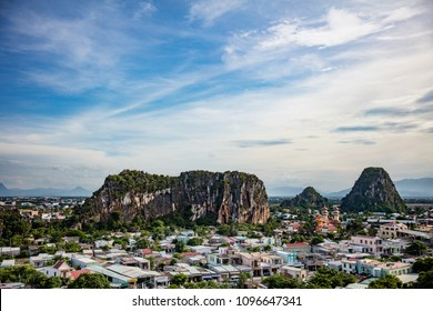 Marble Mountains are a cluster of five limestone and marble hills in the outskirts of Da Nang , Central Vietnam