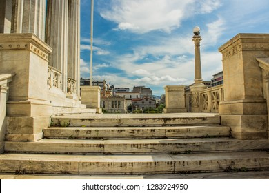 marble palace exterior front side with stairs and columns foreground and city street view background