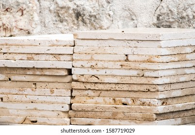 marble, pile of slabs, travertine prepared for incorporation