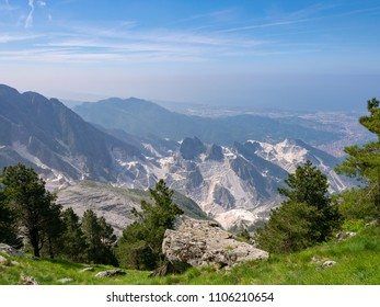 Marble quarries in the Apuan Alps above Carrara, Italy. Industrial landscape. Environmental destruction.