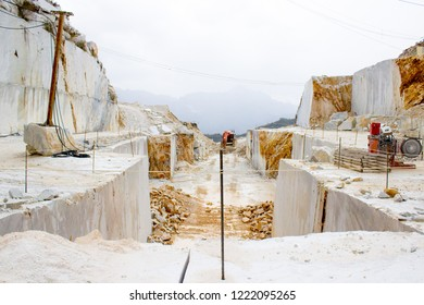 Marble Quarry Carrara, off-road english car, mine, old train tunnel. Marble guided tour, underground cave. Michelangelo's David Marble. Dangerous
