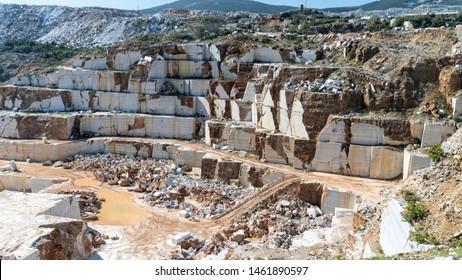 Marble quarry pit full of rocks and blocks in Marmara island, Balikesir, Turkey