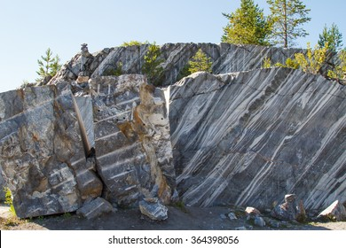 Marble quarry, marble rocks in the wild in the Republic of Karelia. The natural stone. Ancient Marble quarry, marble rocks in the wild. Slices of marble mountain. Tourism and travel.