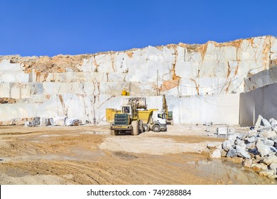 Marble quarry site in Afyonkarahisar of Turkey. Loading into tipper truck by the bulldozer working in the marble quarry.