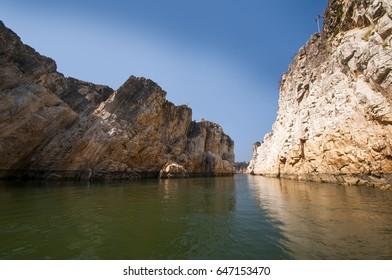 Marble rocks alongside Narmada River, Bhedaghat, Jabalpur District, Madhya Pradesh, India