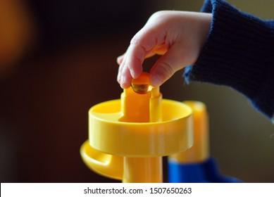 Marble run and a childs hand