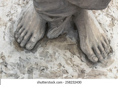 Marble sculpture depicting Jesus' feet.