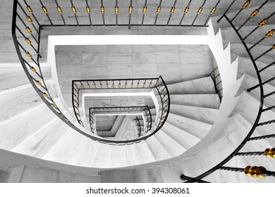 Marble spiral staircase of the modern interior