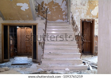 Marble Stairway And Elevator In An Abandoned Building