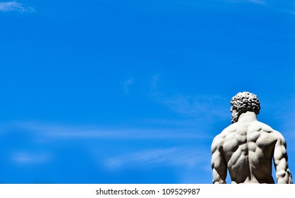 Marble statue against a blue sky