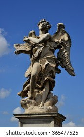 Marble statue of angel with INRI sign from the Sant'Angelo Bridge in the very center of Rome (17th century)
