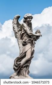 Marble statue of angel on Saint Angel Bridge - Rome